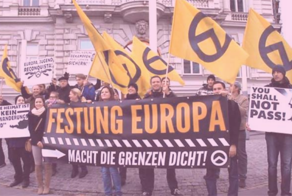 """Photo: """"Demonstration against Morten Kjærum in Vienna"""", by Ataraxis1492 licensed under CC BY-SA 3.0. Hue modified from the original"""