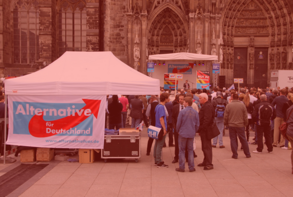 "Photo: ""AfD Wahlkampfauftakt"", by strassenstriche.net licensed under CC BY-NC 2.0. Hue modified from the original"