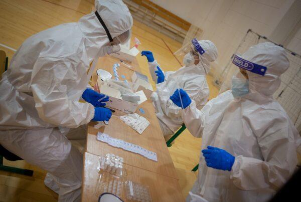 Medical professionals processing PCR tests