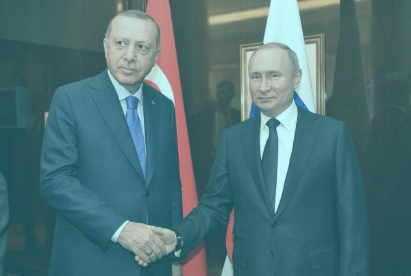 "Photo: ""Vladimir Putin and Recep Tayyip Erdogan (2020-01-19) 01"" by kremlin.ru, licensed under CC BY 4.0. Hue modified from the original"