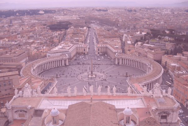 """Photo: """"Saint Peter's Square from the dome"""" by velyag, licensed under CC BY-SA 3.0. Hue modified from the original"""