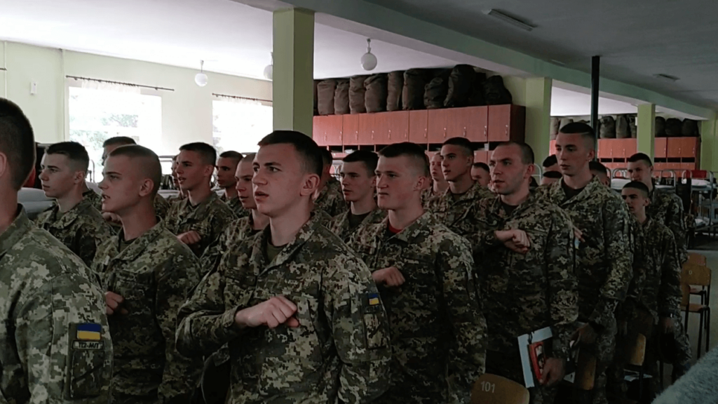 """13 A still from the video posted to Centuria's Telegram shows NAA cadets, led by members of Centuria, reciting the """"Prayer of the Ukrainian Nationalist."""""""