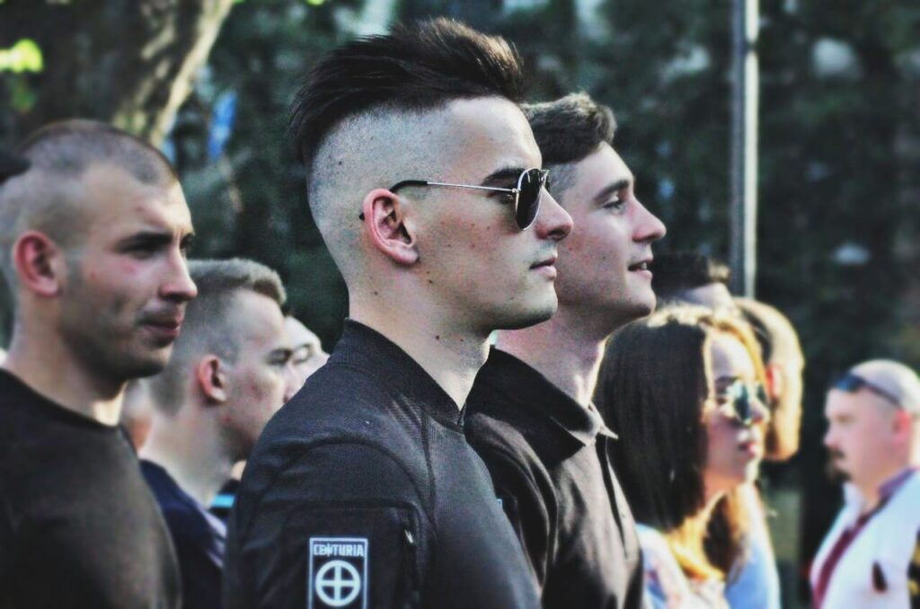 28 Photo posted to VK by apparent Centuria leader Yuriy Gavrylyshyn clearly shows himself (center) with Danylo Tikhomirov to his right and Yevhen Romachenko to his left.