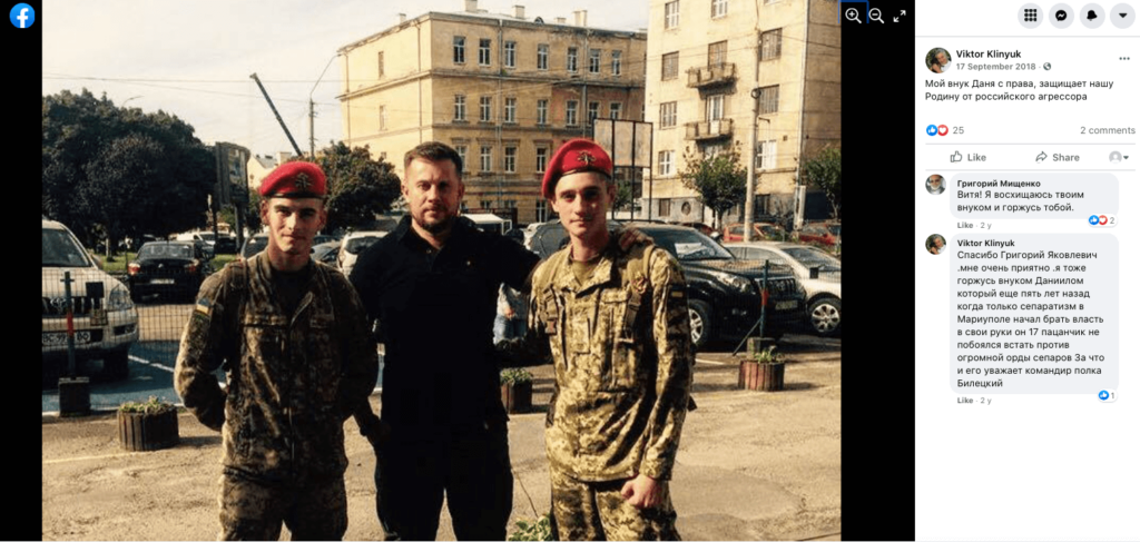 35 Photo posted to Facebook by Viktor Klinyuk, a relative of Danylo Tikhomirov, shows Tikhomirov (right) and Gavrylyshyn (left) with the leader of the internationally active