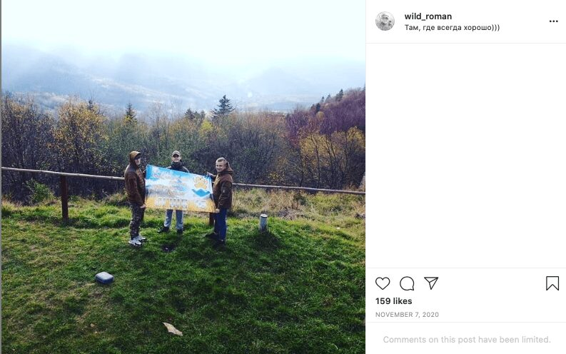 71 Screenshot of a November 2020 Instagram post by Roman Rusnyk. The photo shows Rusnyk (right) with two other men holding a banner bearing the symbol of the 15th Mountain-A